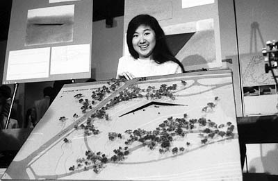 Maya Lin with her design for the Vietnam Memorial, May 6, 1981. Photo Credit: Academy of Achievement
