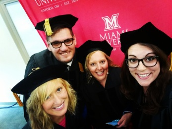 Jose, Greta, Alyssa, and me at our hooding ceremony.